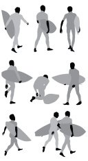Silhouette of people carrying surfboard