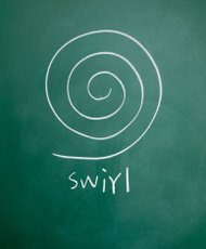 swirl symbol drawn with chalk on blackboard