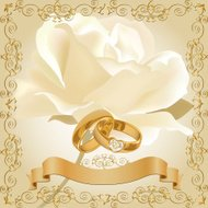 Wedding invitation with white rose and golden diamond rings