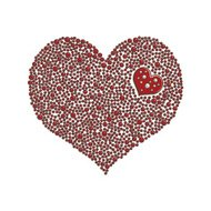 Heart-shaped design element made of red pearls or beads