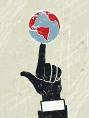 Businessman's Hand With The World Spinning on His Finger