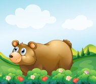 Brown bear in the strawberry garden