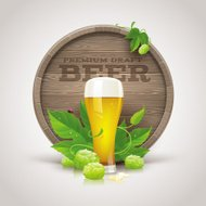 Still life with wooden cask, beer glass and ripe hops