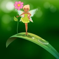 fairy holding  flower standing above a leaf with  dew