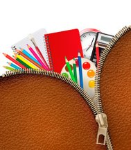 Background with school supplies and zipper.