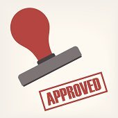 An illustration of a rubber stamp stamping 'Approved' in red