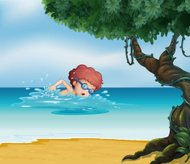 young man swimming at the beach with an old tree