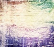 Colorful scratched grunge painted background