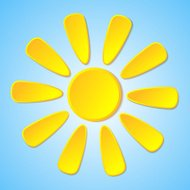 Abstract yellow paper sun on a blue background.