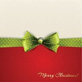 Holiday background in white and red with green dotted ribbon