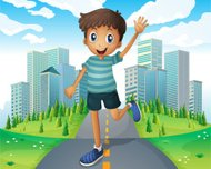 boy waving while running in  middle of the road