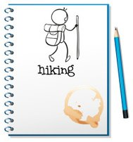 notebook with sketch of a person hiking