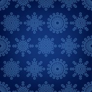 Seamless pattern of snowflakes on a dark background