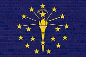 Indiana State flag on brick wall