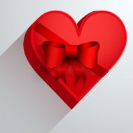 Gift box with red ribbon in the form of heart.