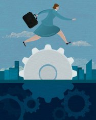 Business concept of businesswoman jumping over gear