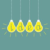 Four hanging yellow light bulbs. Idea concept.