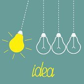 Hanging yellow light bulbs. Perpetual motion. Idea concept.