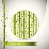 background with bamboo in circle and green ribbon