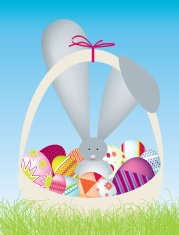easter bunny in a basket of easter eggs