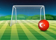 ball at soccer field with the flag of Turkey