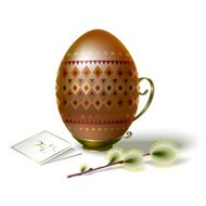 Easter egg with brown ornament and sprig of willow