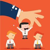 Business hand picking up a  businessman,Human Resources concept