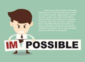 Businessman turning the word impossible