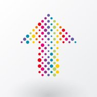 arrow made ​​up of small colorful polka dots