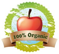 Pure organic label with a red apple