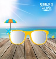Summer holiday background. Sunglassess on wood terrace.