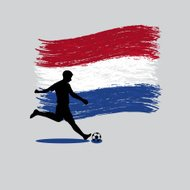 Soccer Player action with Netherlands flag on background