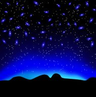 Stars in the sky at night over mountain  background