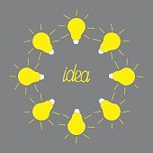 Yellow light bulb round frame on grey background. Idea concept.