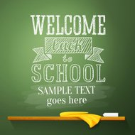 Welcome back to school message on the chalkboard with place