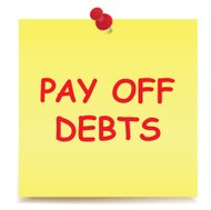 Pay Off Debts Note on Sticky Pad