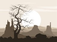 Lifeless landscape with old huge tree and mountains over sunset.