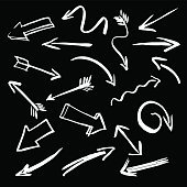 set of white vector arrows and black background
