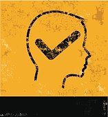 Check mark on head design on yellow background,grunge vector