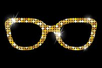 Golden glasses on black background