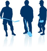 Three construction workers silhouette