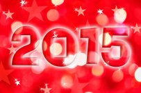 2015 greeting card on red shiny holiday lights background