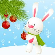 Rabbit with a christmas ball on blue winter background