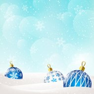 Christmas balls on blue winter background