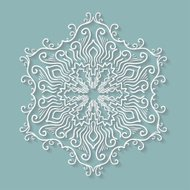 Paper lace doily, decorative snowflake, round crochet ornament.