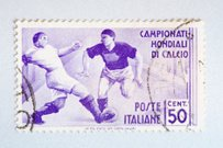 Close up of italian post stamp with soccer player