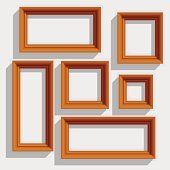 Empty Wooden Brown Picture Frames Isolated on the White Background