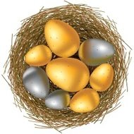 Easter basket with gold and silver eggs on white background