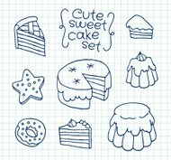 Freehand drawing cute cake on sheet of exercise book