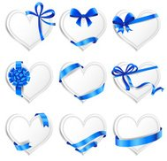 Set of beautiful heart-shaped cards with blue gift bows
